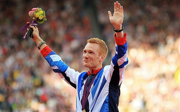 Greg Rutherford on the podium to receive his gold medal for long jump