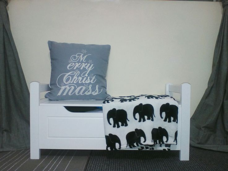 Christmas decor: throw pillow and cute black and white elephant blanket.