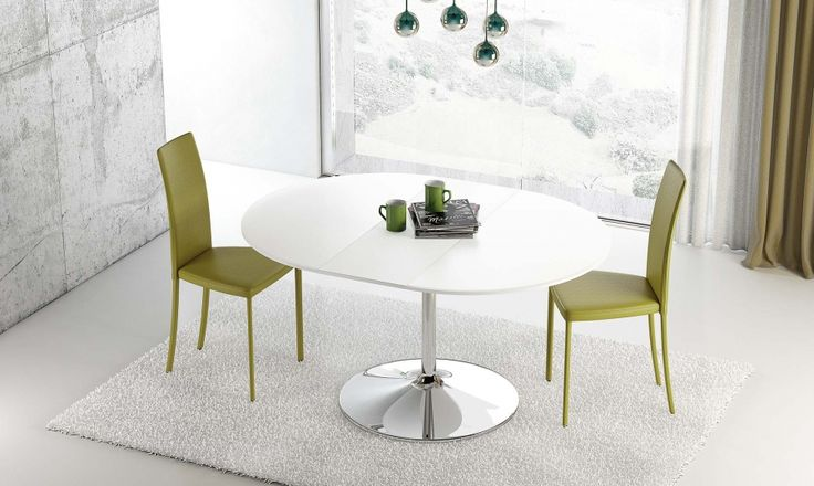 Table Small by RIFLESSI  This pedestal extension table transforms into an oval dining table. Featuring a butterfly extension leaf and a steel pedestal base, this table can accommodate both smaller and larger groups of dinner guests. The Small's clean, modern lines make it suitable for many different interiors.    Available with an extra clear float glass top or a wood top with a matte or high gloss finish.  http://www.format-store.com/en/prod/tables/tables-86/table-small-by-riflessi.html