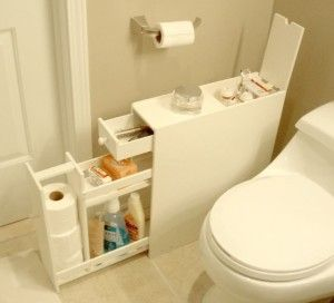 "Bathroom Floor Cabinet bathroom storage ideas - good idea having an ""easy-clean"" side beside the toilet ;P"