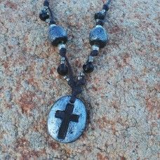 Christian Cross Necklace - Black. The cross has many shapes and forms through various Christian denominations and dates to around 300 AD.The cross holds a deep spiritual empowerment for those dedicated to the Christian faith and peaceful message of Jesus. The cross has a pure and protective quality that wards of negative energies. The cross is a symbol of faith, love and dedication to Christians throughout the world. Hand crafted porcelain – made in Australia. $35.00au  Necklace Length: 76cm