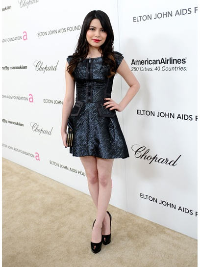 Releasing her rocker edge at the 19th Annual Elton John AIDS Foundation Academy Awards Viewing Party in 2011, Miranda tries a fierce look with metallic zip-up mini and platform shoes.