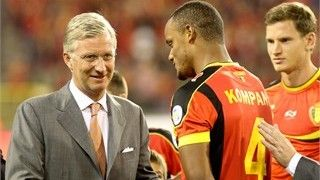 Belgium's Prince Philippe shakes hands with the captain of Belgium's national football team, the Red Devils, Vincent Kompany
