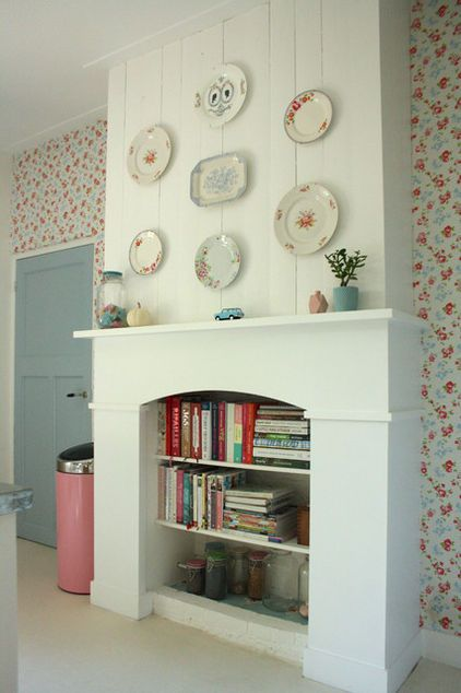 Great idea for an old fireplace! eclectic kitchen by Holly Marder