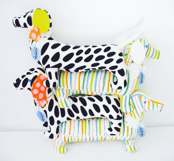 This fun, one of a kind retro daschund soft toy made with colourful striped Scandinavian fabric and decorated with embroidered eyes and a flower