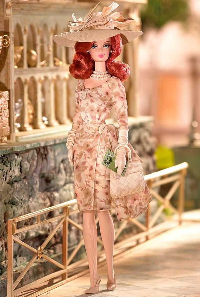 Day at the Races™ Barbie® Doll  Barbie® doll takes advantage of a fabulous British tradition — a day at the races! The best-dressed gal at the track in a frock of floral pastel hues with gloves, handbag and de rigueur wide-brimmed hat to complete the glamorous ensemble!