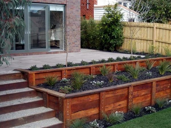 Raised flower beds. I like the terraced appearance. Would be great on the side of a deck.
