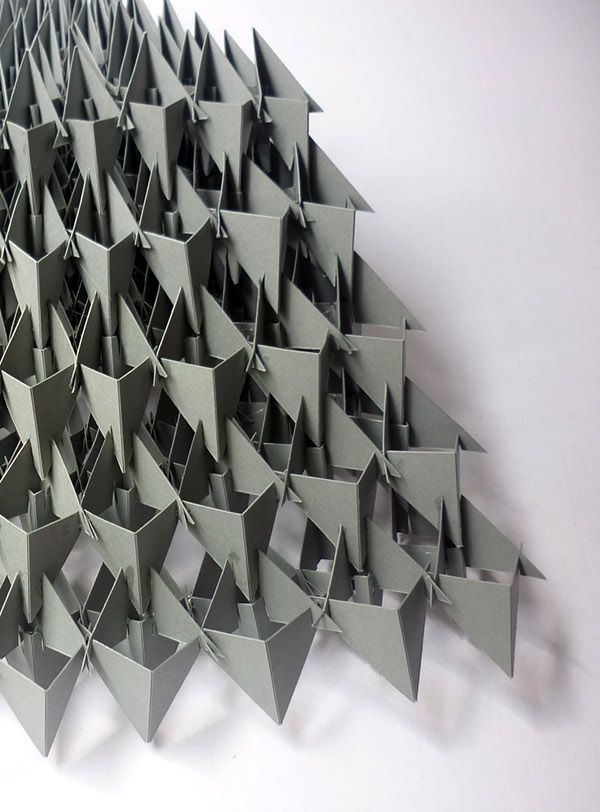 This project was a study about forms. The single element is a triangle. The structure is made up of paper triangles without any glue.