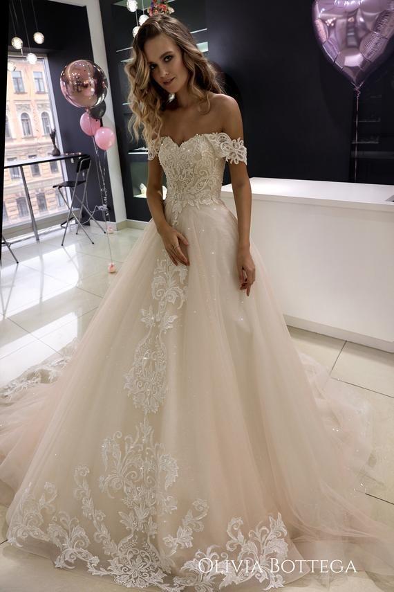 Off the shoulder wedding dress Ivia by Olivia Bottega. Open Etsy