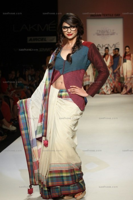 Prachi Desai wore an ecru sari with colorful plaid borders and a belly baring long sleeved choli as showstopper for Shruti Sancheti at Lakme Fashion Week Summer/Resort 2013 in Mumbai on Monday, March 25.