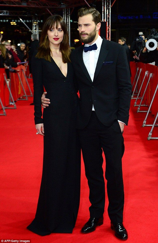 Hot stuff: Dakota Johnson made an appropriately sexy sartorial display as she attended the official screening of Fifty Shades Of Grey at the Berlin Film Festival as she posed alongside her handsome co-star Jamie Dornan at the annual festival held in the German capital