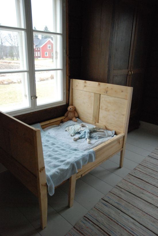 An old wooden bed for the little one.