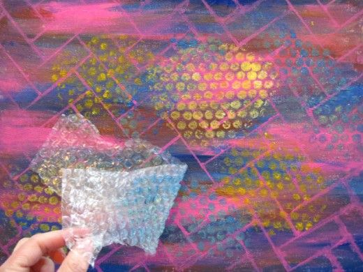 Using bubble-wrap to add texture to an abstract painting