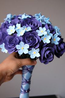 bride with purple roses and forget me nots and bridesmaids with blue roses and yesterday today and tomorrows