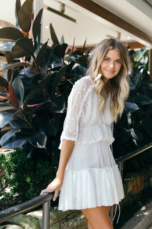 Boho dress, white eyelet dress, white tiered dress, cute spring outfit ideas, what to wear on vacation | They All Hate Us