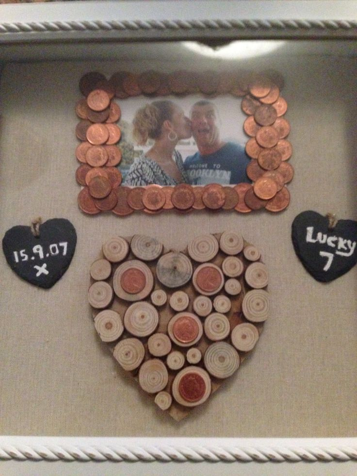 7th wedding anniversary gift to my husband x 7 years is copper so all 1p and 2p coins around the frame Are dated 2007 and the 4 1p coins on the heart are his birth year, my birth year, the year met and the year we got married.