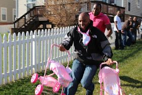 Coed baby Shower- Relay race for the guys. Maybe they could blow up a balloon and put it under their shirt, eat apple sauce, chug from a bottle, and change a diaper or get a stroller to the finish-line the fastest.