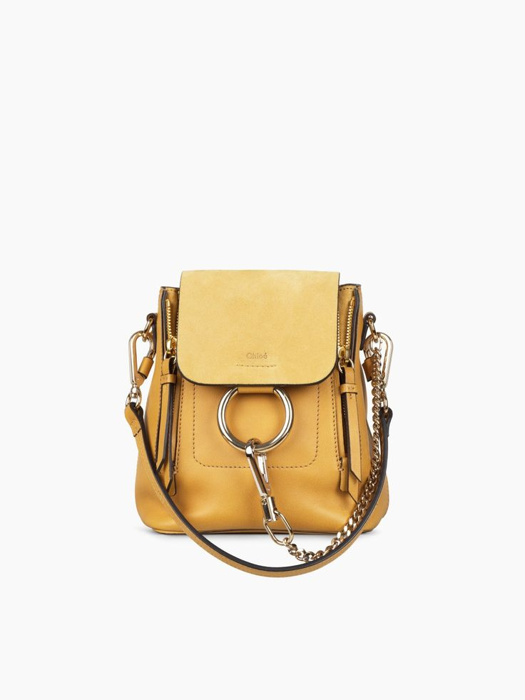 A festive take on Chloé's iconic Faye bag, this time as a mini backpack in dusty yellow smooth & suede calfskin