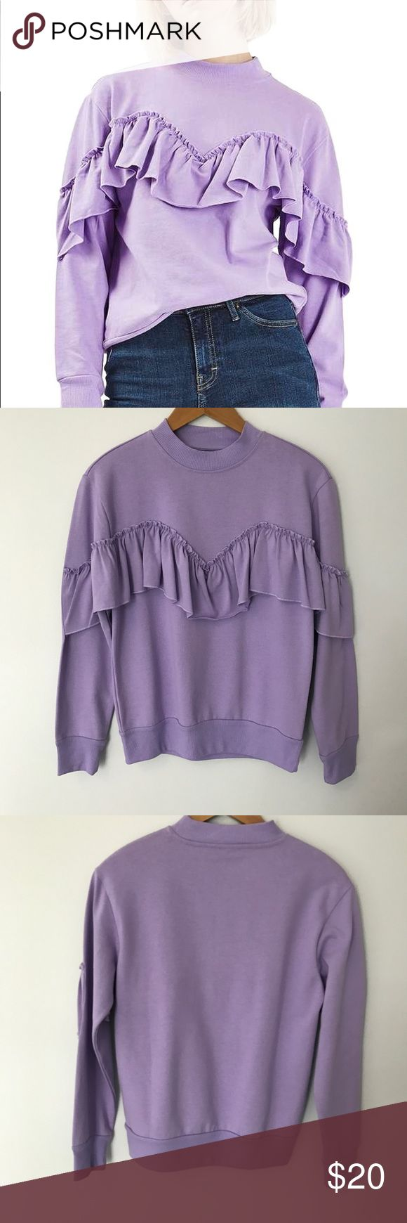 Topshop Purple Jersey Ruffle Sweatshirt Smocked raw-edge ruffles draw an exaggerated sweetheart neckline on this '80s-inspired sweatshirt made from soft heathered jersey.  Crewneck Long sleeves Ribbed neck, cuffs and hem Topshop Tops