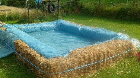 Hay + rope + liner + water = pool for a day!
