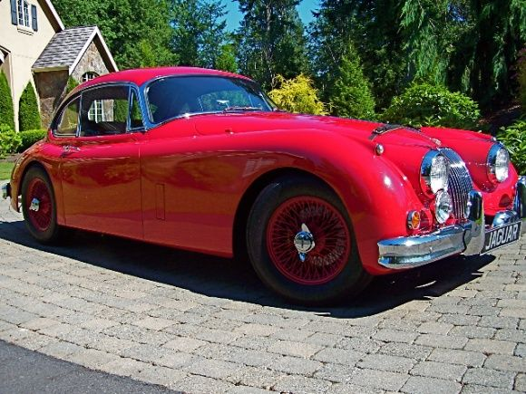 1960 Jaguar XK150 FHC , Had a ground up  restoration some 15 years ago. I would like to see it with a set of chrome wire wheels instead of the painted wheels. v@e.