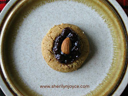 """Raspberry Almond Thumbprint Cookies.  The perfect holiday treat!  Find this recipe and many more in my FREE ebook """"The Gluten Free Holiday Survival Guide"""" ---> http://sherilynjoyce.com/gluten-free-holiday-recipes/"""