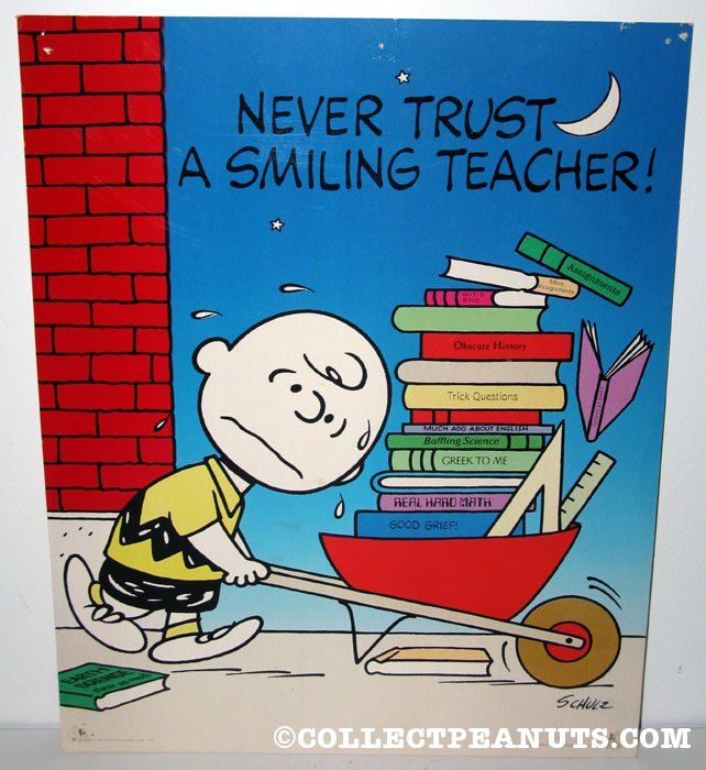 Peanuts Posters | CollectPeanuts.com - Charlie Brown with wheelbarrow of books 'Never trust a smiling teacher' Poster
