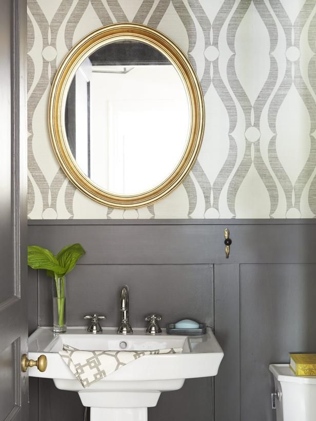 "Printed grass cloth wallpaper and brownish-black painted wainscoting (Black Fox by Sherwin-Williams) are a sophisticated duo in the bath. ""It's a bold pattern in a small room,"" says Ceri. ""But it works because the colors are muted."
