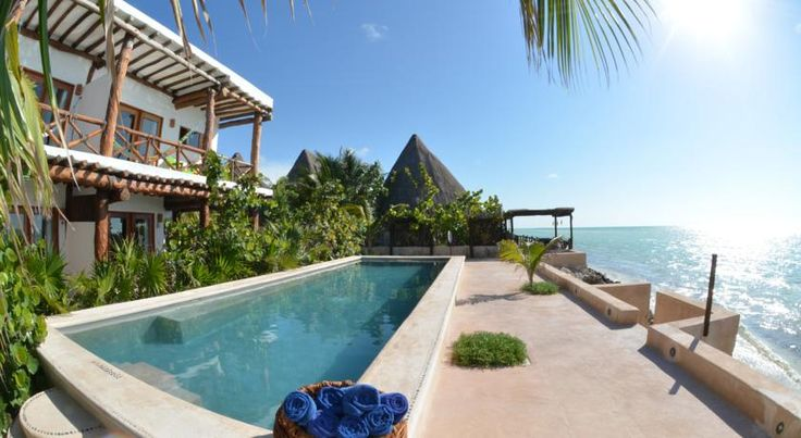 Las Nubes de Holbox Holbox Island This boutique hotel is located on the secluded island of Isla Holbox, just steps from the beach. The hotel offers ocean views, spa, ironing, laundry and babysitting services for an extra fee.