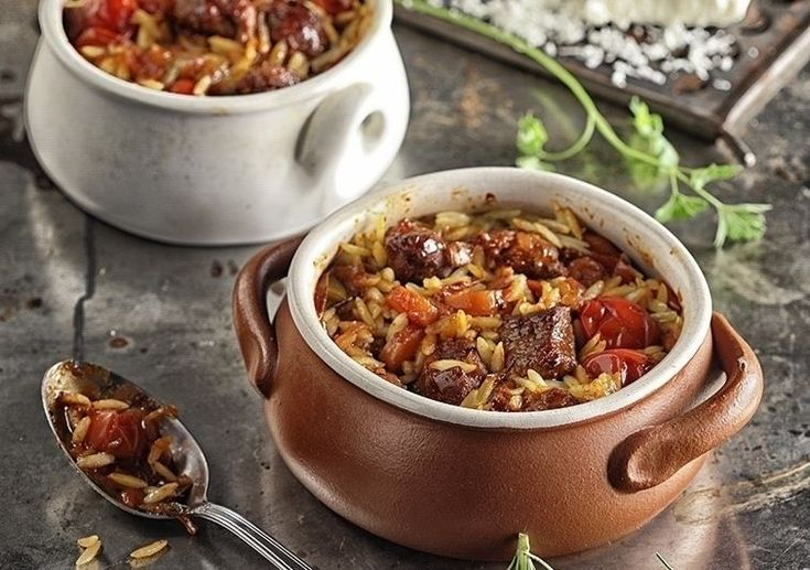Lamb and Orzo Baked Stew!!      -Ingredients -          1200 g leg of lamb, boneless 2 onions, cut into slices 1 green pepper, cut into small cubes 2 carrots, cut into small pieces 1 can of chopped tomatoes 2 tablespoons tomato sauce ½ cup white wine 250 g large orzo 2 tablespoons honey some fresh rosemary some parsley 250 g feta cheese olive oil 1 beef bouillon cube salt pepper