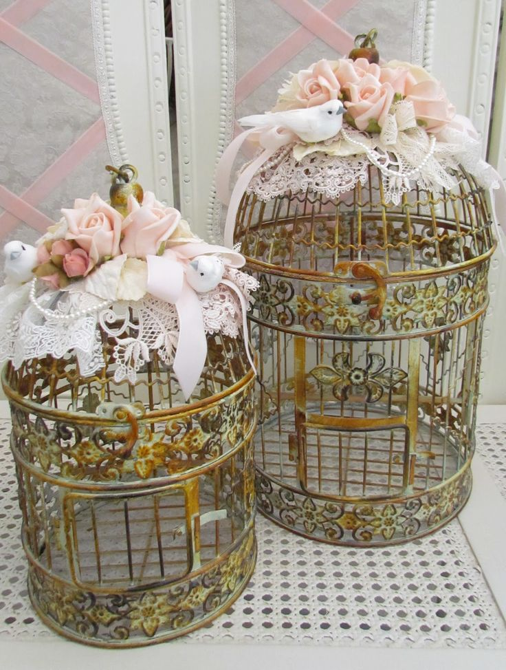 Beautiful way to decorate a birdcage!  Lace, ribbon, flowers and a ...  BIRD!