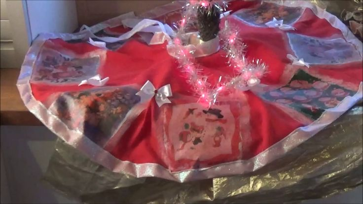 """This video presents how to make a Christmas tree skirt using fabric, interfacing and the decoupage on fabric technique. Αυτό το βίντεο παρουσιάζει πως φτιάχνω ποδιά Χριστουγεννιάτικου δέντρου χρησιμοποιώντας ύφασμα, καρίνα και την τεχνική ντεκουπάζ σε ύφασμα """