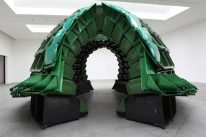 """Vancouver-based artist Brian Jungen created this domed 'turtle shell' out of industrial waste and recycling bins. The installation, Carapace, is   meant to explore Brian's native culture """"in the context of today's   contemporary consumerist society and state of globalization."""" In past   works Brian has used plastic chairs, hockey equipment, and plastic food   trays. (via designboom)"""