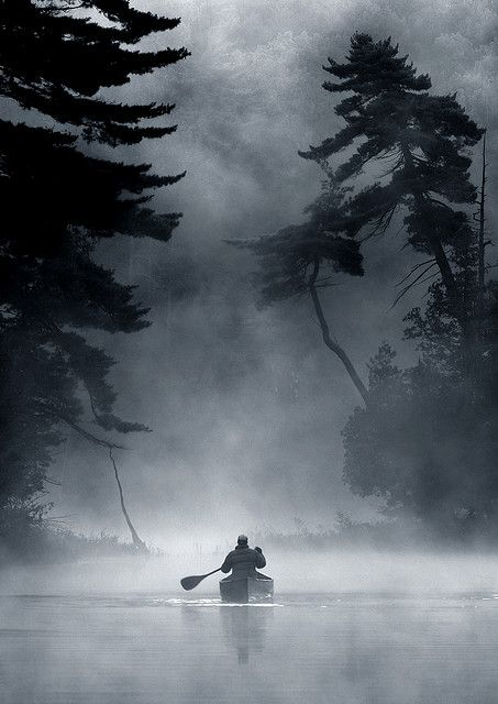 Paddler in the early morning mist. Leslie Frost wilderness area, Ontario, Canada. Peter Bowers.