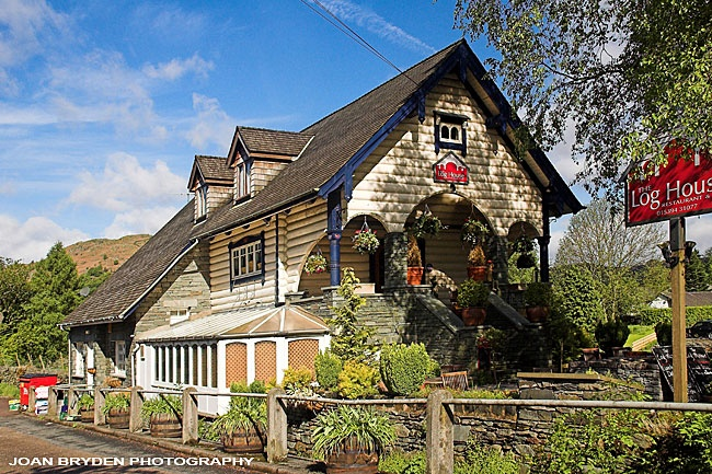 The Log House, Ambleside, was shipped over from Norway by the artist, Heaton Cooper Senior (Arthur) as his studio. First in Coniston, possibly near the Ruskin Museum, it was then moved to Ambleside. After he died it became a coffee shop. The conservatory is a later addition.