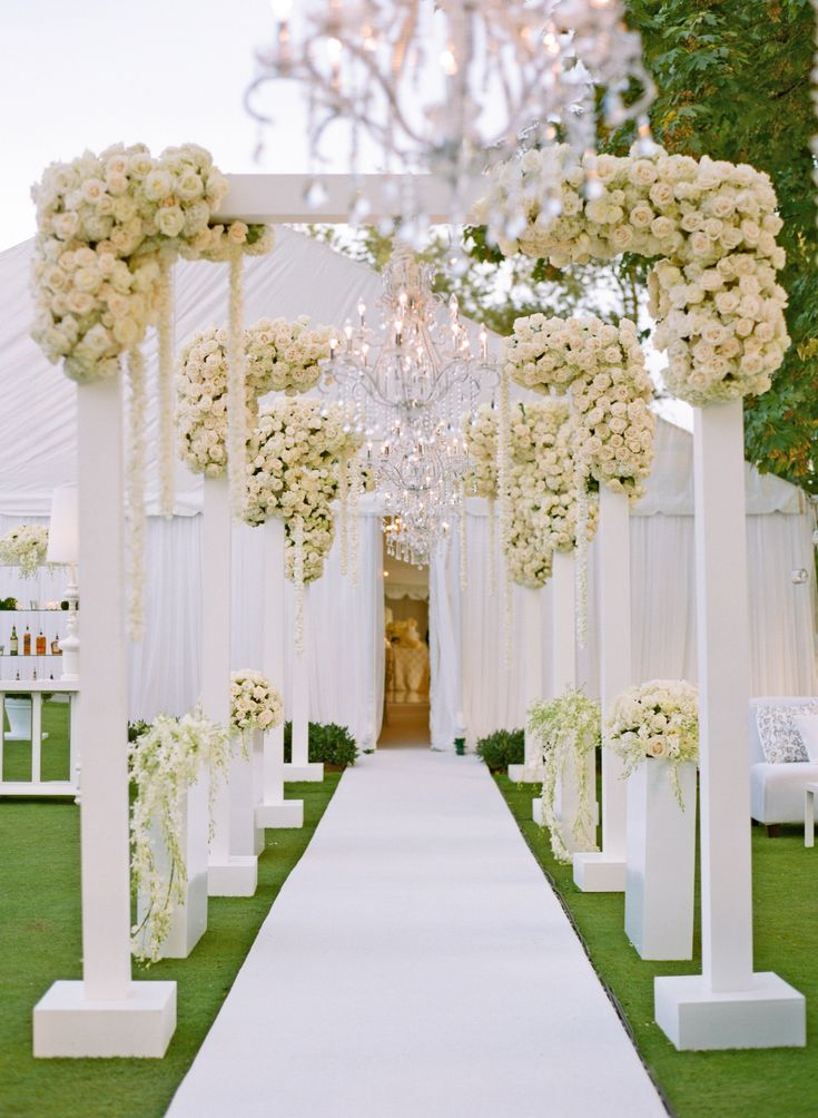 Aisle in White Arch Tunnel with Roses | Photography: Aaron Delesie Photographer. Read More: http://www.insideweddings.com/weddings/elegant-all-white-country-club-wedding-with-natural-greenery/530/