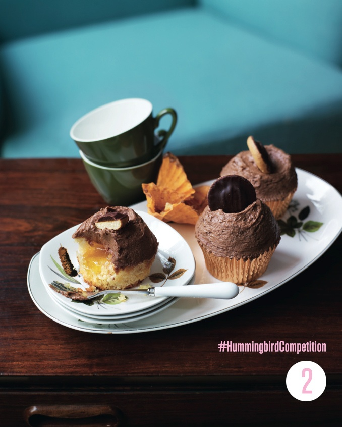 Jaffa Cake Cupcakes. Enter our #HummingbirdCompetition by March 6th, 2013 for a chance to win 1 of 3 free Home Sweet Home cookbooks. Rules and how to enter can be found here: https://www.facebook.com/notes/the-hummingbird-bakery/win-a-copy-of-home-sweet-home/567680519908799
