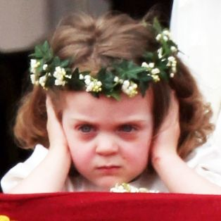 The infamous photo: 3-year-old Grace van Cutsem, Prince William's goddaughter looks so miserable in the picture because of the heavy commotion and applause surrounding the palace, although we didn't know why until later.
