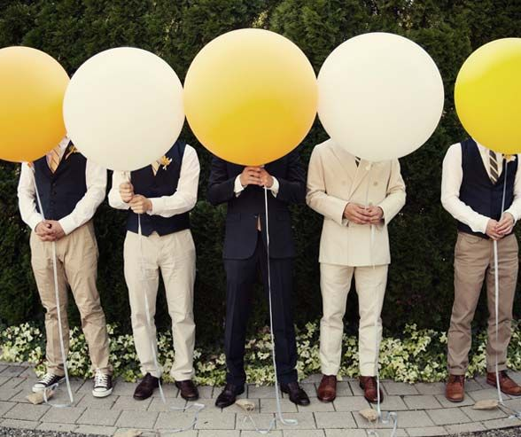 In shades of white, khaki, and navy, these mis-matched but coordinated groomsmen are ready for action!