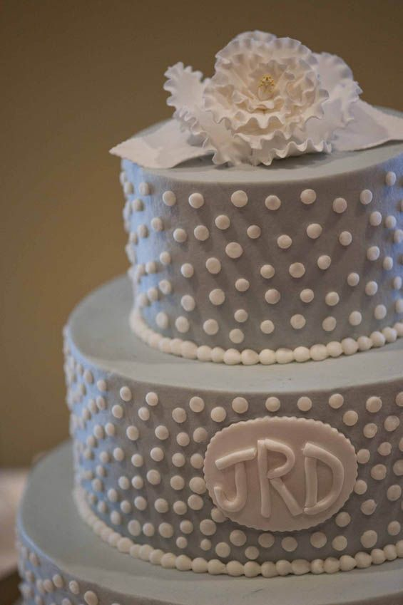 Love everything about this cake: the polka dots, monogram and baby blue color