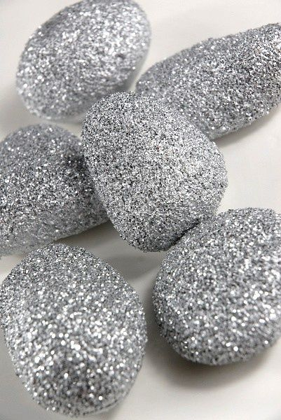 super inexpensive for centerpieces! - paint rocks with glue and sprinkle with whatever color glitter and fill a vase