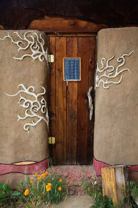 Cob house door, I think the vines are made from a material called skratch