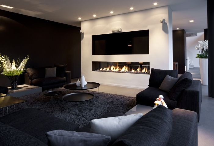 The cosy living room with a nice fireplace. Here we can read a ...