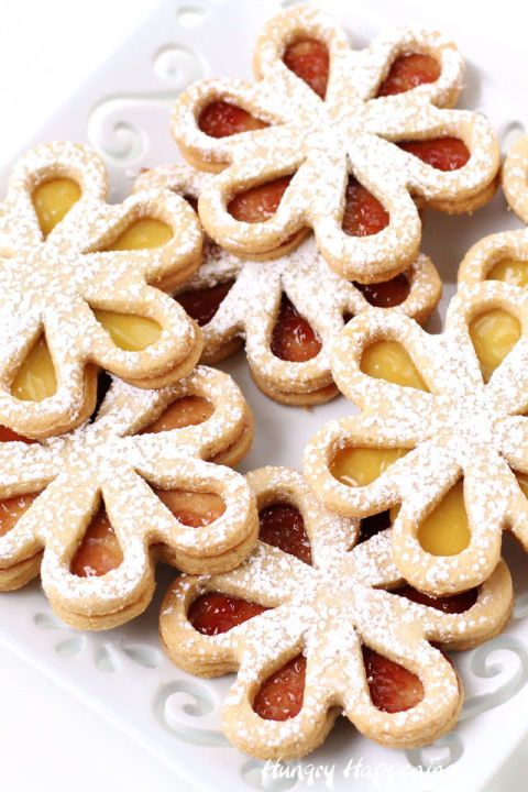 Linzer Cookie Daisies: These cookies will be a hit at your holiday dessert table, but they're also perfect for birthdays, tea parties, brunches, and more. These linzer cookies are tasty whether you fill them with raspberry or chocolate filling. Find more easy and delicious  linzer cookie recipes and ideas for Christmas here.