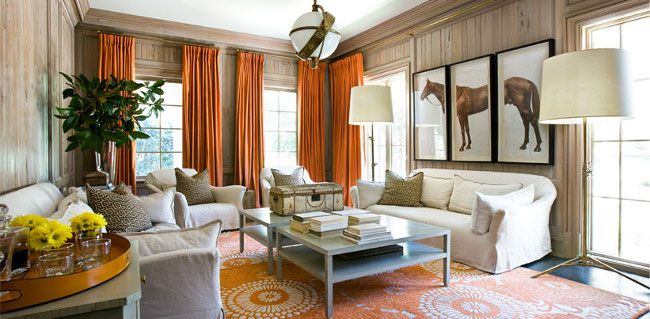 I'm not overly partial to orange, but I love it in this room mixed with the wood paneling and overall feel.