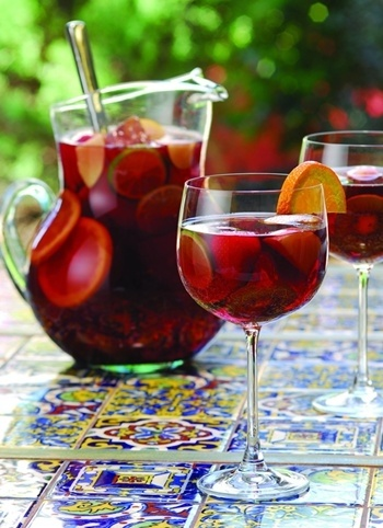 No-Stress Sangria - hey, it's a drink not a contest  :)   1 bottle inexpensive (≤$10) dry red wine, chilled; ½ cup cognac; ½ cup orange liqueur (e.g. Grand Marnier); 2 red apples, cored & quartered; 2 Granny Smith apples, cored & quartered; 2 oranges, halved; 1 lemon + lime, halved; Club or lemon-lime soda.  Thinly slice fruit (remove seeds). Combine with alcohol. Use wooden spoon to lightly bruise fruit. Cover and rest in refrigerator at least 8hrs; stir occasionally.  Add soda to serve.