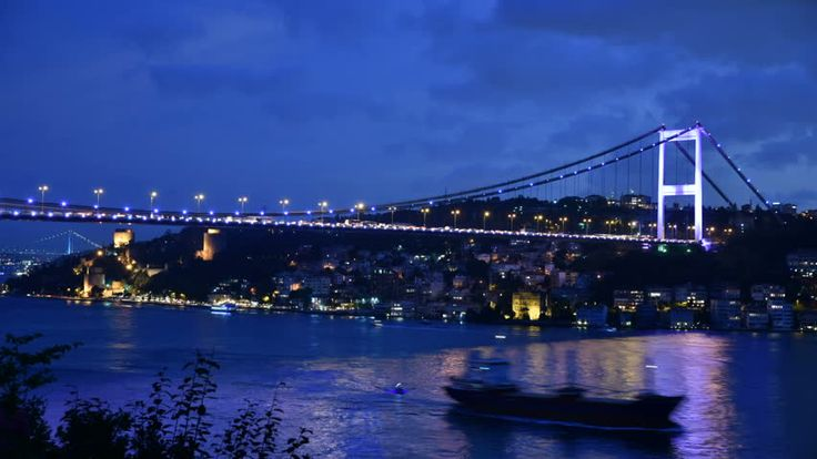 Time Lapse Of The Fatih Sultan Mehmet Bridge By Night. Some Boats And Ships Are Passing The Bosphorus. The Rumeli Fortress And The Bosphorus Bridge In The Background Too. Stok Video Klip 11801813 - Shutterstock