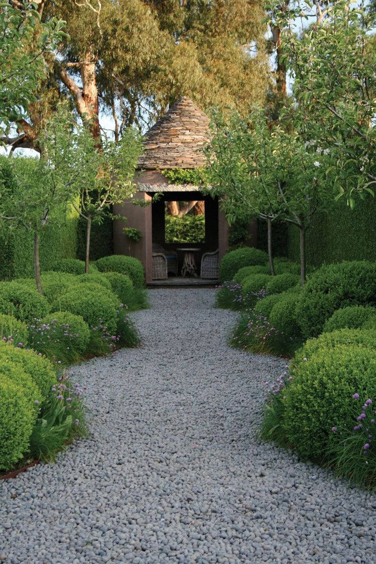 Rosemary bushes and olive trees lead down the path to a darling cottage.