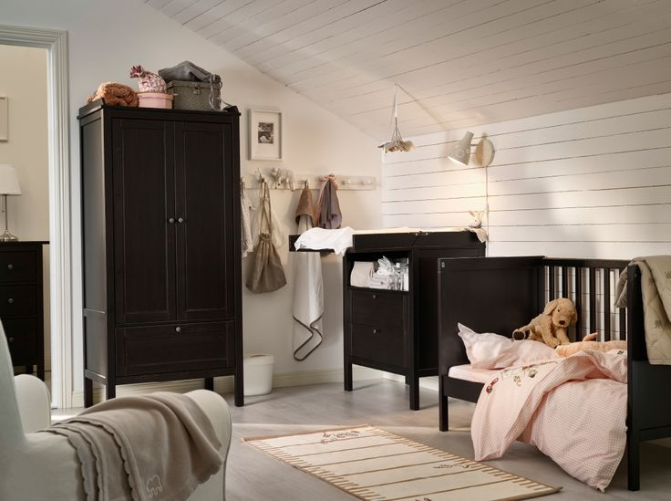 Gender Neutral Nursery | IKEA | Traditional furniture for a calm, welcoming and cosy nursery | Gender Neutral nursery with cot, change table and wardrobe, all in black-brown  >>> Please Pin Now and be Inspired Later <<<