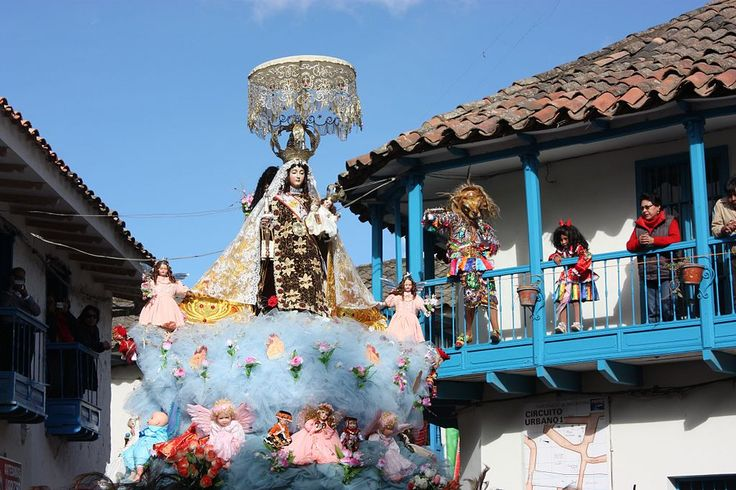 Procession of the Virgen del Carmen in Perú -- In the background, on the balconies, there is a representation of a demon who is not able to step outside because of the presence of the Virgin.